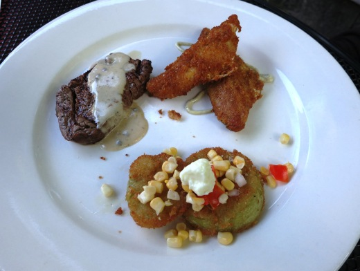 Beef filet, fried green tomatoes, and corn meal-dusted Lake Erie Perch